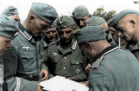 Wehrmacht soldiers reading a map.jpg